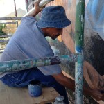 "Artist Charles ""Boko"" Freeman restoring ""Return to the Light"""