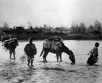 Mexicans crossing El Rio Grande into the United States