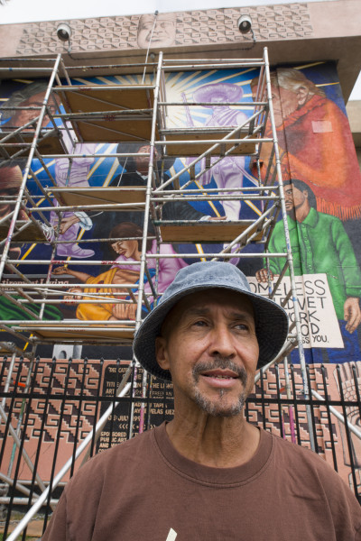 "Charles ""Boko"" Freeman in front of his mural"