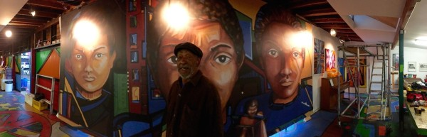 Roderick Sykes standing in front of the stretched print.