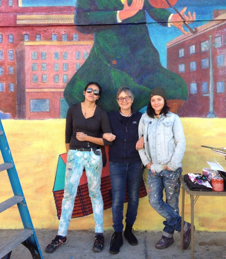Christina Schlesinger posing with Citywide Mural Restoration Team members, Myisha and Ariel.