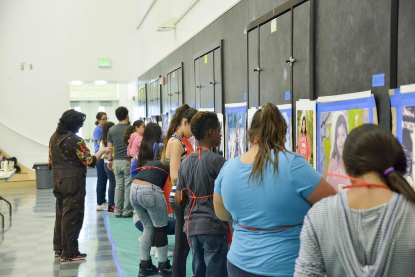 JB Arts students painting self-portraits.