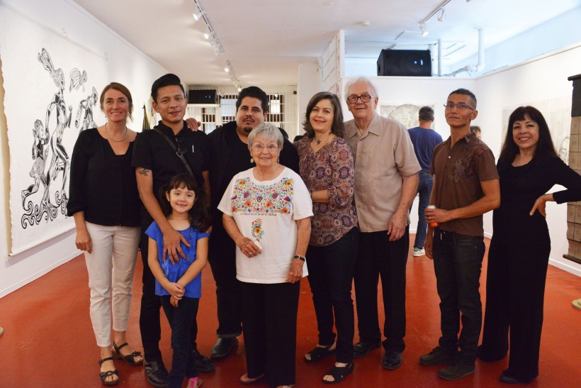 Artists from the exhibit. L to R: Marianna Sadowski, Pavel Acevedo and daughter, Daniel González, Kay Brown, Poli Marichal, Dan Newton, Nguyen Ly, and Yvette Mangual. Not Pictured: Sergio Sánchez Santamaría and Joel Rendón.