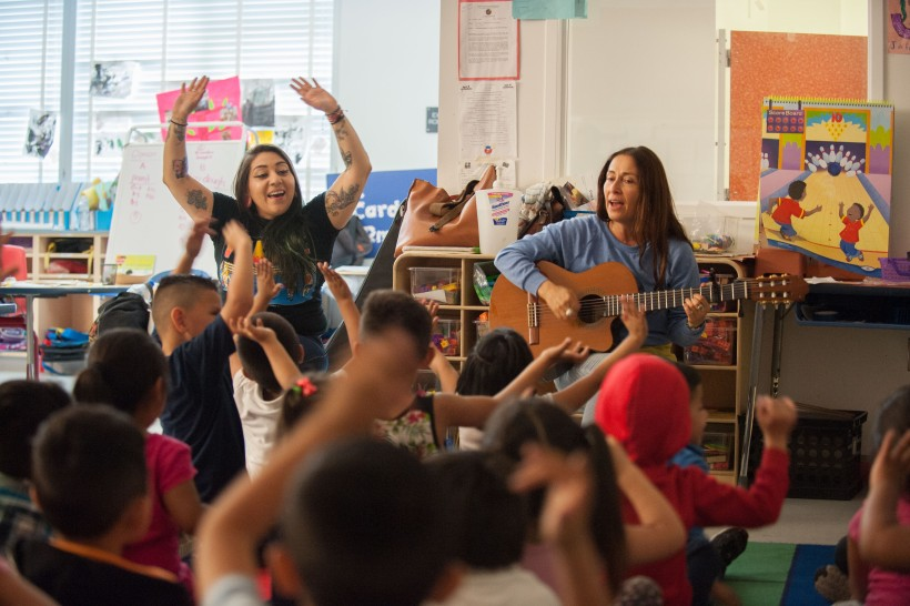 Teaching Artist, Jacqueline Fuentes, and Teaching Assistant, Leslie Guardado, during a music session.