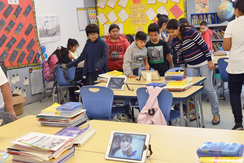 Ms. Dominguez's 5th grade students during a gallery walk after a photography and photo-editing workshop on iPads led by Teaching Artist, Mary-Linn Hughes.