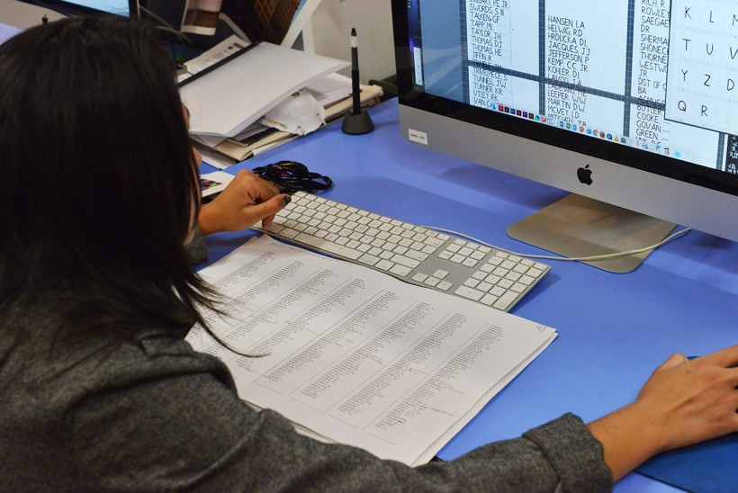 Myisha Arellano finalizing POW and MIA names for print.